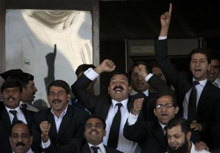 Lawyers chant slogans in favour of a decision by the Supreme Court of Pakistan outside the court building in Islamabad