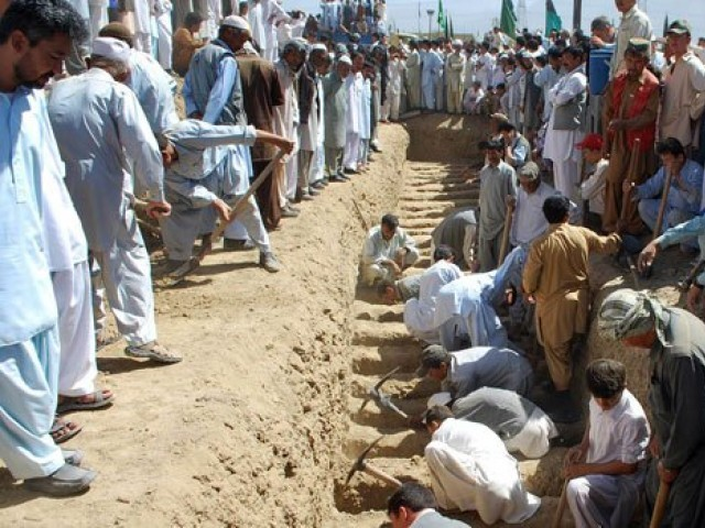 Shia Muslims dig graves for their community members at a graveyard in Quetta, Sept 21, 2011, after their killing in an attack by gunmen. PHOTO: AFP
