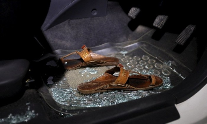 Broken glass in the car where Sabeen was murdered - Reuters