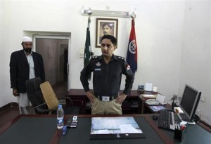 Pakistani police superintendent Sohail Zafar Chattha is seen at his office in Rahim Yar Khan in the eastern Punjab Province March 2, 2013. REUTERS/Faisal Mahmood