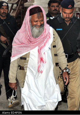Malik Ishaq escorted to court by the police