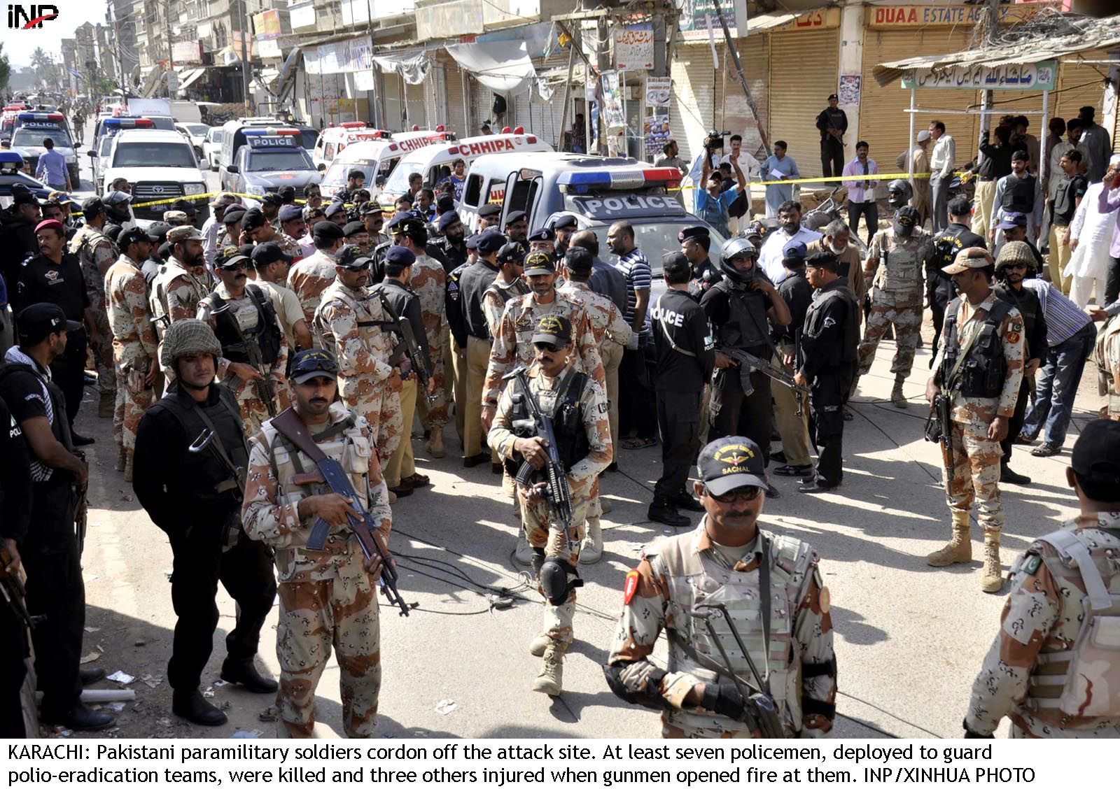 KARACHI: Pakistani paramilitary soldiers cordon off the attack site. At least seven policemen, deployed to guard polio-eradication teams, were killed and three others injured when gunmen opened fire at them. INP/XINHUA PHOTO