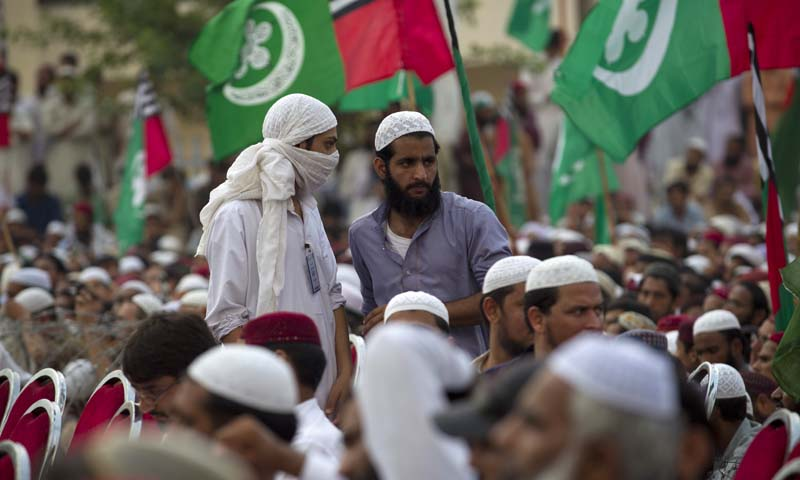 Supporters of banned sectarian group Sipah-e-Sahaba listen to their leaders during a gathering to observe the anniversary of their leader Azam Tariq assassinated in 2003, Friday, Oct. 4, 2013 in Islamabad, Pakistan. Leaders demanded that Pakistan government should hold peace negotiation with Taliban, allegedly involved bombings and suicide attacks. (AP Photo/B.K. Bangash)