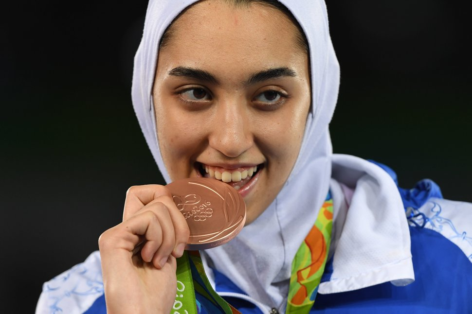 Iran's Kimia Alizadeh Zenoorin poses with her bronze medal on the podium after the womens taekwondo event in the -57kg category as part of the Rio 2016 Olympic Games, on August 18, 2016, at the Carioca Arena 3, in Rio de Janeiro. / AFP / Kirill KUDRYAVTSEV (Photo credit should read KIRILL KUDRYAVTSEV/AFP/Getty Images)